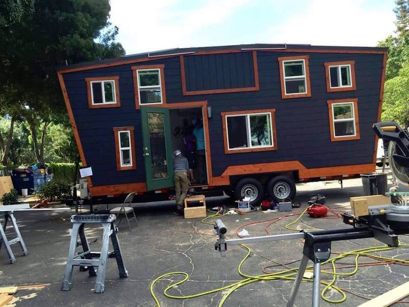 A tiny house rolls into mega mansion land news24 for Tiny house mansion